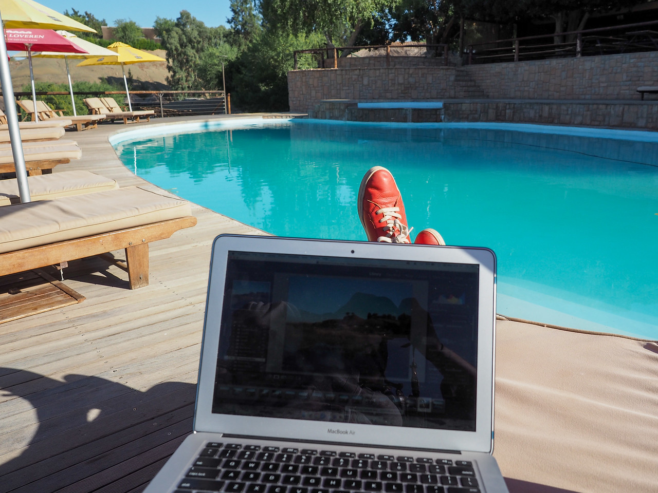 Working by a pool in Namibia