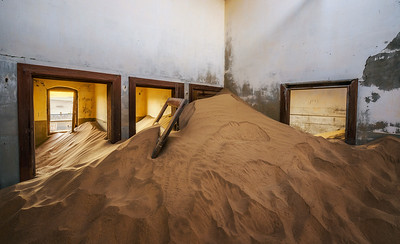 Ruins of a house filled with sand in the mining town Kolmanskop, Namibia