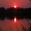 Za 3997 opkomende zon boven Okavango Rivier