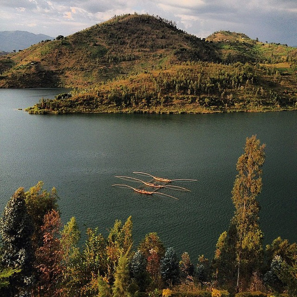A late afternoon tandem fishing expedition before the storms roll in. A view from our deck on the edge of Lake Kivu in the town of Kibuye, #Rwanda. via Instagram http://ift.tt/1iWqNTN