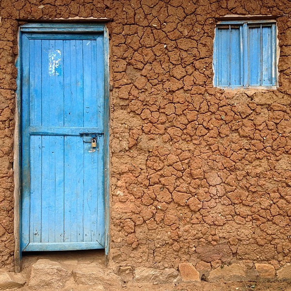 Favorite village doorway candidate #33. Tidy and blue. Taken outside the village of Nyakinama, northwestern Rwanda. via Instagram http://ift.tt/1t4o3to