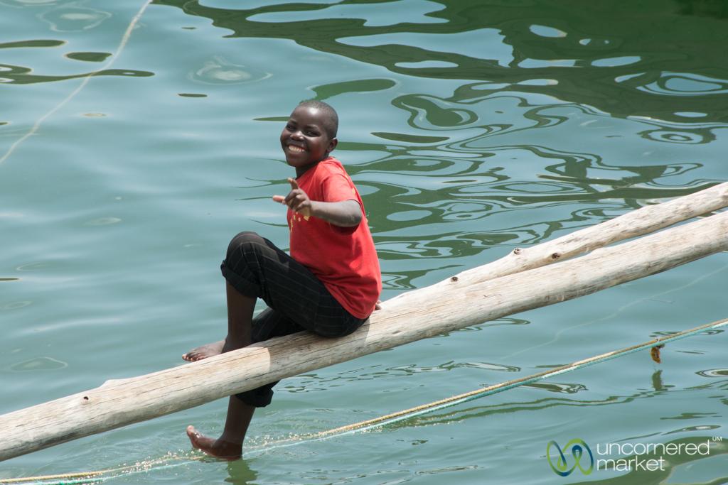 Laughing Kid on Fishing Boat - Lake Kivu, Rwanda