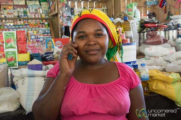 Rwandan Woman Talking on Mobile Phone - Kibuye Market, Rwanda