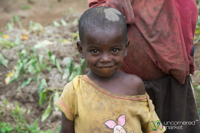 Rwandan Girl With Piglet Shirt - Musanze, Rwanda