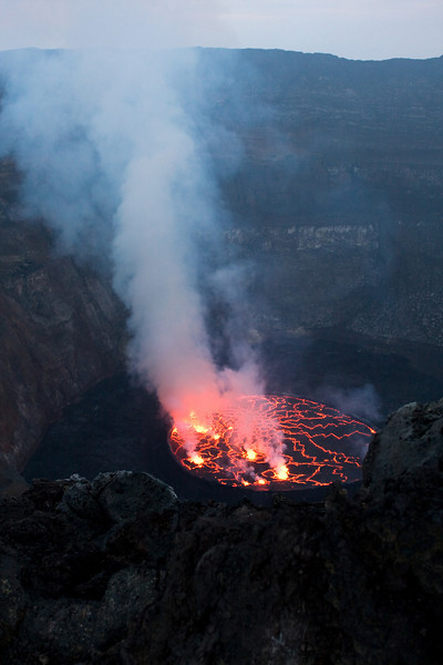 The lava lake inside the crater shows a number of different faces throughout the day, which evolve as the lighting changes.  This is it during daytime.<br /> <br /> Location: Nyiragongo volcano, Goma, Democratic Republic of Congo (DRC)<br /> <br /> Lens used: 24-105mm f4.0 IS