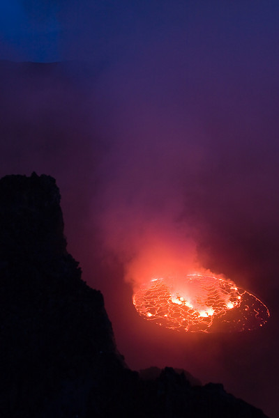 Here's another face of Nyiragongo's lava lake.  This is at dusk.<br /> <br /> Location: Nyiragongo volcano, Goma, Democratic Republic of Congo (DRC)<br /> <br /> Lens used: 24-105mm f4.0 IS