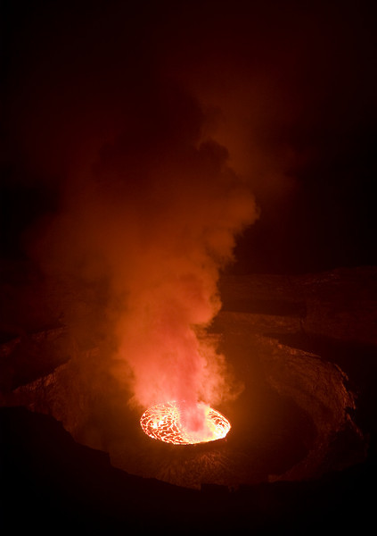 At night, the lake glows like the fiery inferno that it is.  The illuminative glow inside the crater is somewhat akin to sitting around the coolest campfire imaginable.<br /> <br /> Location: Nyiragongo volcano, Goma, Democratic Republic of Congo (DRC)<br /> <br /> Lens used: 10-22mm f3.5-4.5