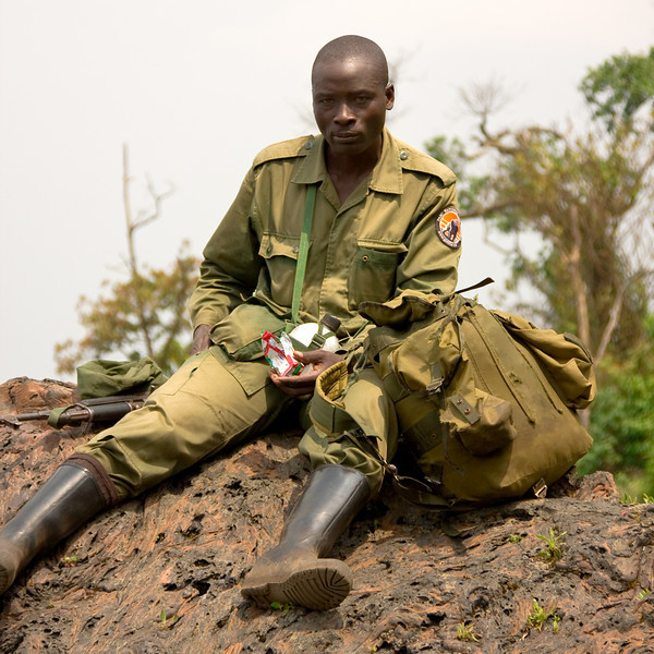 A ranger with the Virungas National Park (of which the volcano is a part) taking a snack break.<br /> <br /> Location: Nyiragongo volcano, Goma, Democratic Republic of Congo (DRC)<br /> <br /> Lens used: 24-105mm f4.0 IS