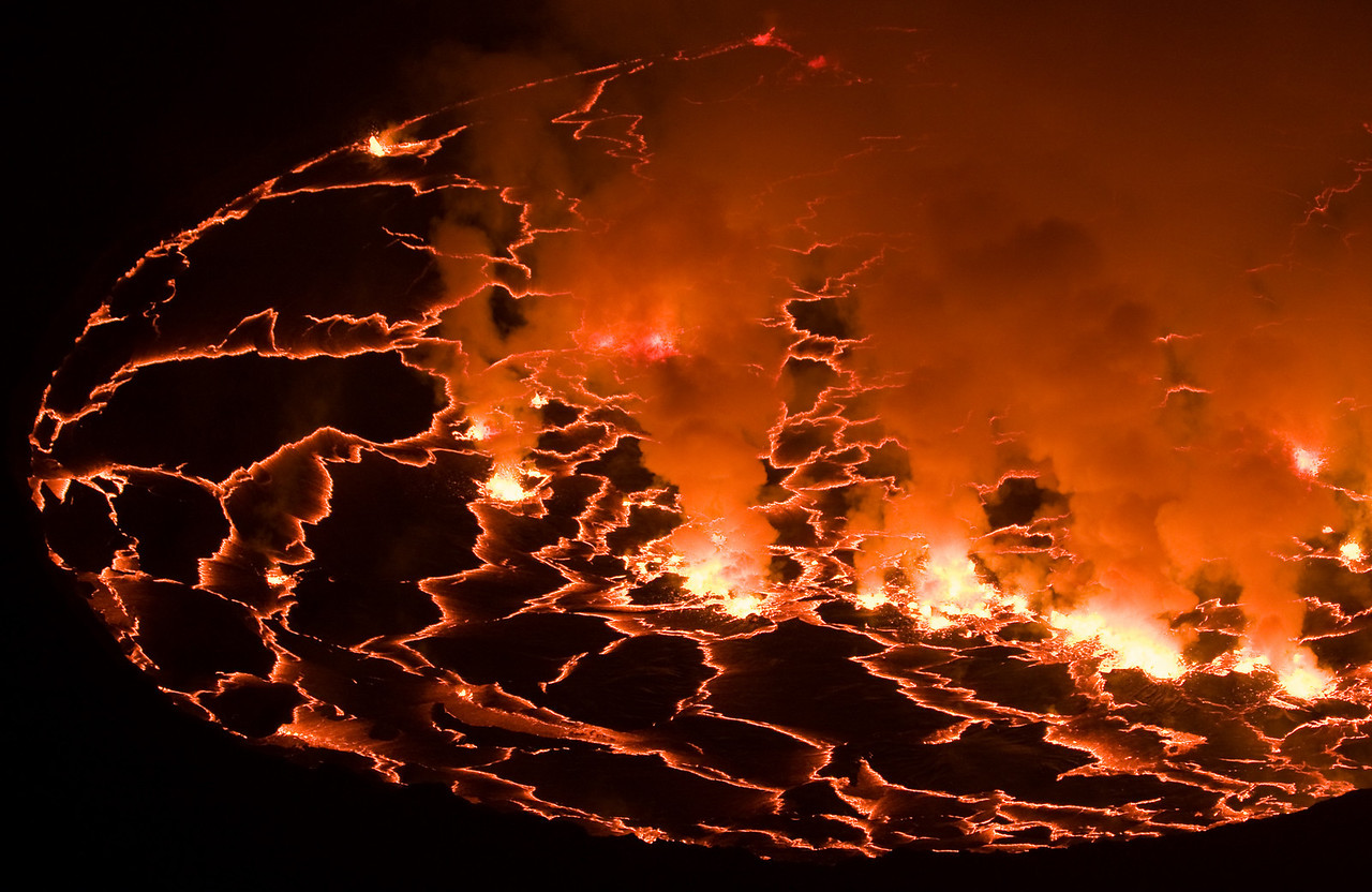 With full dark, you could see nothing but the bright convection points where the lava was actively boiling and the glowing fracture lines radiating out along the cooled lake crust.<br /> <br /> Location: Nyiragongo volcano, Goma, Democratic Republic of Congo (DRC)<br /> <br /> Lens used: 100-400mm f4.5-5.6 IS