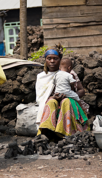 A woman selling charcoal finds a calm moment while sitting along the roadside with her child.<br /> <br /> Location: Goma, Democratic Republic of Congo (DRC)<br /> <br /> Lens used: 24-105mm f4.0 IS