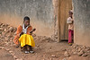 After church, young girl playing string game. Near Mbirizi, Burundi.