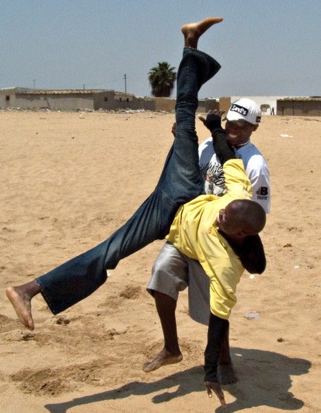 Men, Namibe, Angola--these guys did a whole mock fight on the beach.