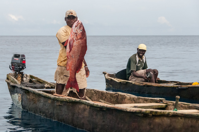 Fishermen on boat in Principe, Sao Tome and Principe