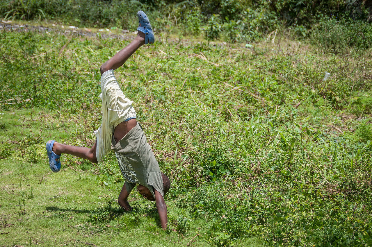 Child doing cartwheel in Sao Tome, Sao Tome and Principe