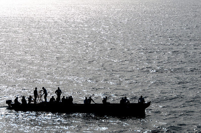 Silhouette of fishermen on boat in Sao Tome, Sao Tome and Principe