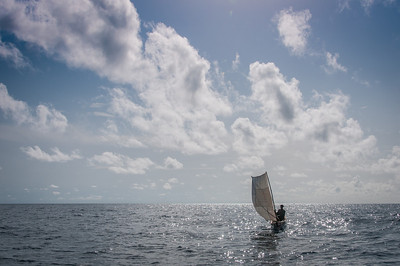 Man on an improvised sailboat in Sao Tome, Sao Tome and Principe