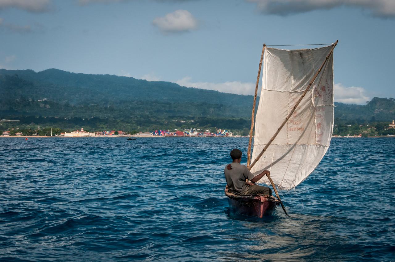 Man on a fishing boat in Sao Tome, Sao Tome and Principe