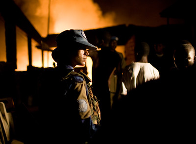 MONROVIA - LIBERIA , FEBRUARY 8 2007 :On patrol in Monrovia, investigating a large fire in the city which turned out to be garbage on fire.  All female Peacekeeping police force from India are part of the UN's Form Police Unit which provides backup on patrol for local unarmed Liberian National Police  .  (Photos by : Christopher Herwig )
