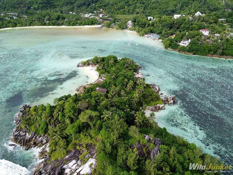 visit seychelles - seychelles travel guide - anse l'islette from the drone