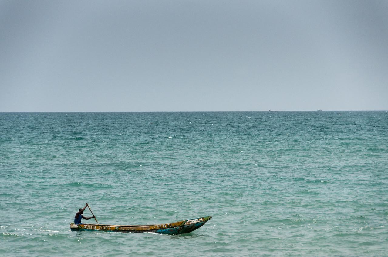 Man on a boat in Freetown, Sierra Leone