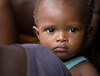 FREETOWN, SIERRA LEONE - AUGUST,2006:  Young baby boy. The underdeveloped district of Kroo Town. (Photo by: Christopher Herwig)
