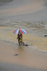 FREETOWN PENINSULA, SIERRA LEONE - AUGUST,2006: A young boy and girl with umbrella on the rainy beach. Beaches around the village of Sussex on the Freetown Peninsula.<br /> Sussex, Freetown Peninsula, Sierra Leone<br /> Foto: Christopher Herwig - Kod 9266