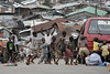 ARKIV 060802 - Kids playing football ( soccer ) on the busystreets of Kroo town.<br /> Freetown, Sierra Leone<br /> Foto: Christopher Herwig - Kod 9266