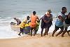 Sierra Leonean fishermen pulling in a boat