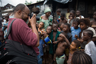 FREETOWN, SIERRA LEONE - AUGUST,2006:  Kroo Bay in the capital Freetown where the Sesay family lives. Leonard Pitts having fun with the local kids. (Photo by: Christopher Herwig)
