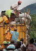 ARKIV 060803 - Baby being lowered from the top of a truck loaded with cargo and passengers ontop. Moyamba Junction.<br /> Road to Bo, Sierra Leone<br /> Foto: Christopher Herwig - Kod 9266