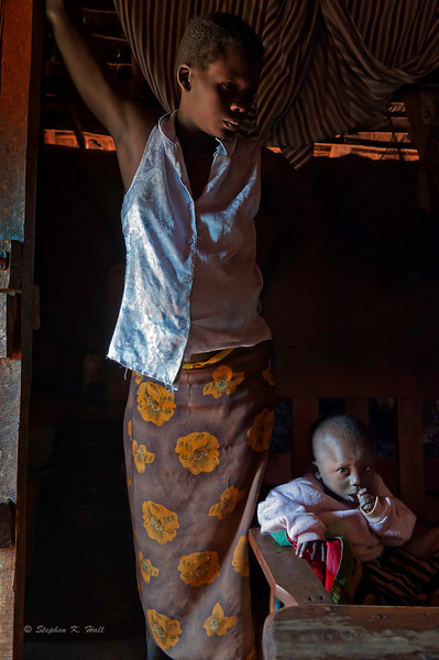Mother and child during HIV home health visit. Rural health initiative. Matibabu Foundation. Ugenya, Kenya