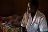 Lost in thought. Father dying of AIDS, son as caregiver. Ugenya, Kenya.