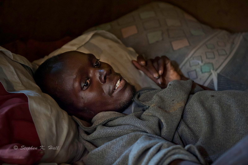 AIDS patient at home near death. Western Kenya.