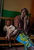 Home visit, HIV/AIDS rural health initiative. Grandmother and child. Matibabu Foundation. Ugenya, Kenya
