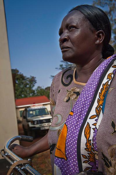 Volunteer rural health worker about to begin rounds. Ugenya, Kenya.