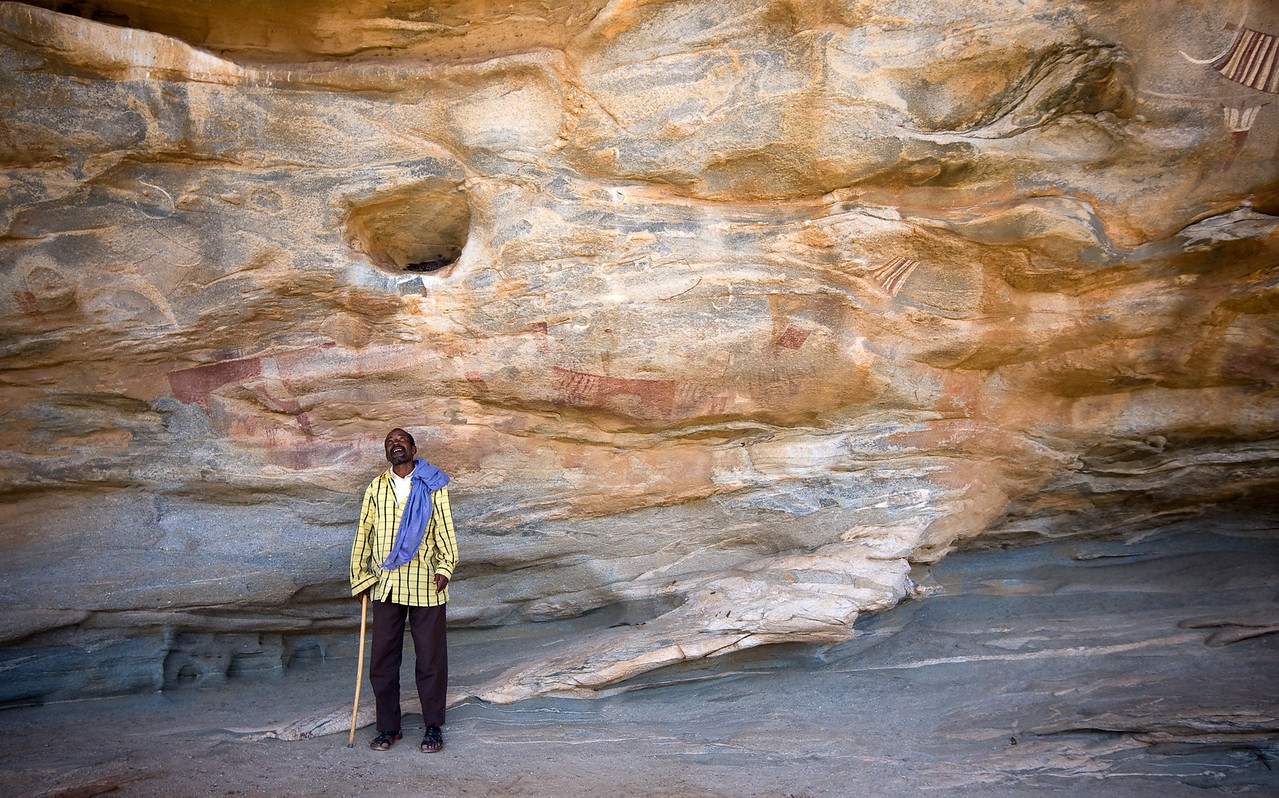 The remote sites' caretaker accompanies all visitors (all 3 or 4 of them a day) to the caves.<br /> <br /> Location: Las Geel, Somaliland<br /> <br /> Lens used: 10-22mm f3.5-4.5