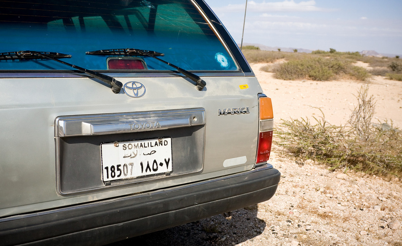 Though not recognized by any other nation on earth, Somaliland is very much a de facto independent state with, among other things their own vehicle license plates.<br /> <br /> For those a little rusty on the Arabic script numerals, practicing translating passing car's plates was a productive way to pass the time while driving across the desert.<br /> <br /> Location: Outside Berbera, Somaliland<br /> <br /> Lens used: 24-105mm f4.0 IS