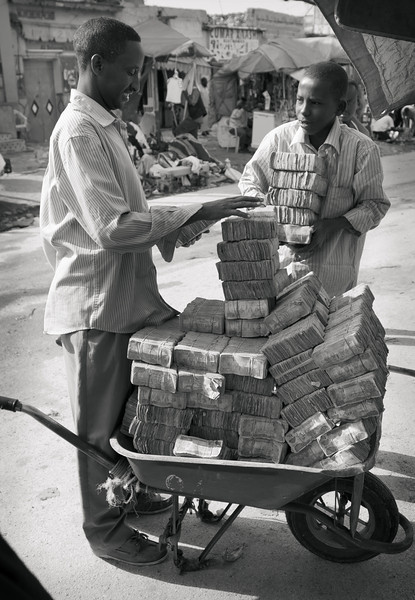 Most of us have probably at one time or another joked about needing a wheelbarrow to carry all our money around.<br /> <br /> Location: Hargeisa, Somaliland<br /> <br /> Lens used: 24-105mm f4.0 IS