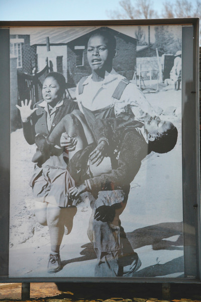 Mbuisa carrying his brother away from the plave he was shot in Soweto.