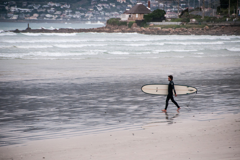 Surfer on the beach in Cape Town, South Africa