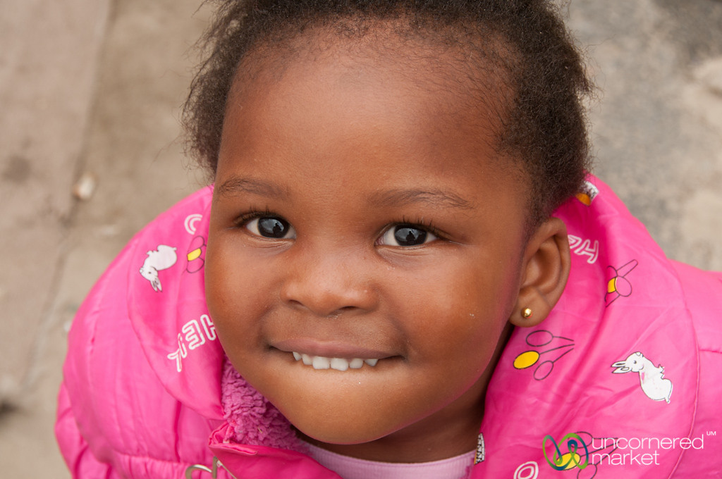 South African Child and Smile at Masiphumelele Township - Cape Town