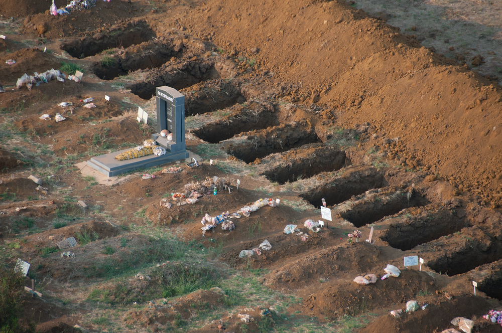 Freshly dug graves as seen from a hot air balloon in South Africa