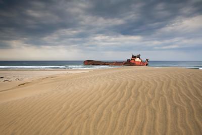 Jolly Rubino shipwreck along sand dunes near Cape St. Lucia.