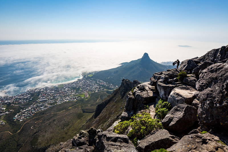 Abseiler on Table Mountain with Camps Bay and Lion's Head Mountain