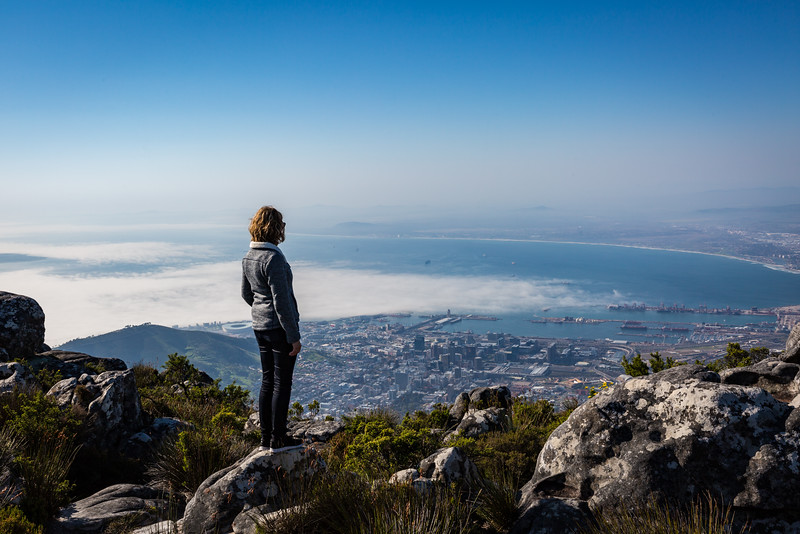 Tourist on the top of Table Mountain looking out towards the V&A and port.