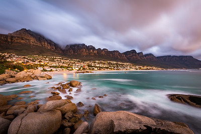 Long exposure at sunset at Camps Bay with cloud over Table Mountain and the 12 Apostles