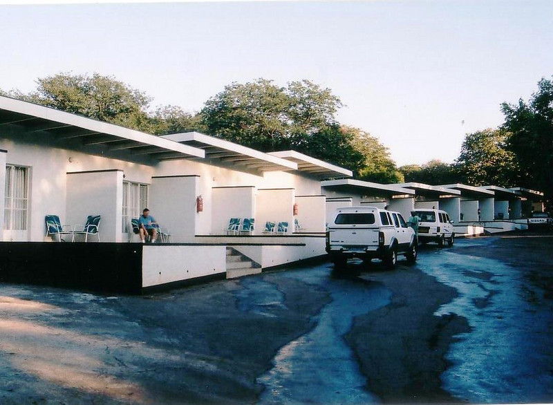 Sprayview Hotel, Victoria Falls, Zimbabwe with our Nissan truck parked in front of our room. A very comfortable budget hotel, with pool and restaurant, close to the Falls. 2002