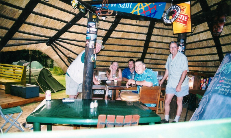 "2002: Johannesburg Airport backpackers, John (far left) and I (standing) in the  hostel's garden thatch roof bar. <br /> <br />  <a href=""http://hotels.lonelyplanet.com/hotel/Johannesburg-Airport-Backpackers-P134638.html"">http://hotels.lonelyplanet.com/hotel/Johannesburg-Airport-Backpackers-P134638.html</a>"