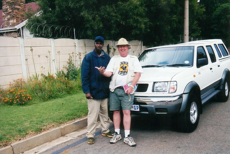 Johannesburg Airport backpackers hostel.    2002: John with my Nissan truck from Avis, which we used driving  to Botswana, Zimbabwe, Zambia and back to South Africa. I'd recommned this, it was a good adventure, excpet for running out of gas in Zimbabwe with none available.  A good natured couple on their way to Durban, gave us a 5 gal can of gas which just got us back to the border of South Africa.