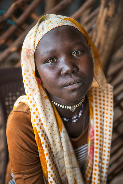 Young shop girl. Gendrassa, Maban County, Republic of South Sudan